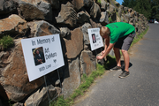 Ryan O'Meara, who manages the Wildwood Golf Course established by his parents in 1991, pauses to straighten memorial signs during the Brody Borlaug Memorial Golf Tournament, which raises funds for the Doernbecher Children's Hospital at OHSU.