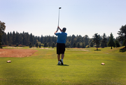 A golfer tees off during the Building Owners and Managers Association's annual golf tournament, held in July at The Reserve Vineyard and Golf Club in Aloha.