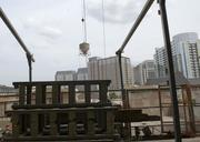 Work continues inside and out of the 22-story Uptown high rise.