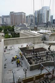 Workers complete concrete work on the Stoneleigh Residences pool deck.