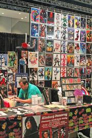 Thom Dunaway manned the booth for his wife, Kimberly, who had several of her illustrations on display.