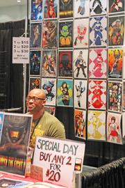 J. Alonzo Clark of Superhero Talent Agency talked to visitors at his booth during FandomFest.