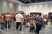 """Fans waited in line at the Kentucky International Convention Center to meet actors Norman Reedus and Michael Rooker from """"The Walking Dead"""" and comic legend Stan Lee."""