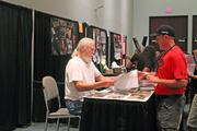 """Actor Scott Wilson from """"The Walking Dead"""" signed an autograph for a fan."""