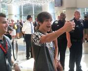 Pop singer Austin Mahone takes his picture with a cell phone.