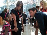 Ryan Seacrest talks with 7-year-old Darien Gray, a former Levine Children's hospital patient.