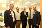 Andy May, with Cushman & Wakefield and Metropolitan Ministries board member; Preston Farrior COO with Ferman Motor Car Co. and board member; Nelson Black, director of lending, Florida Community Loan Fund; Bruce Tigert, Metropolitan Ministries board chairman; and Robert Shimberg, Hill Ward Henderson attorney and board member, after the tour.