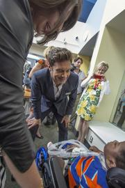 Ryan Seacrest greets a patient at the opening of Seacrest Studios at the Levine Children's Hospital.