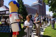 The Hot Dog Racing Sausage greets downtown Milwaukee employees.