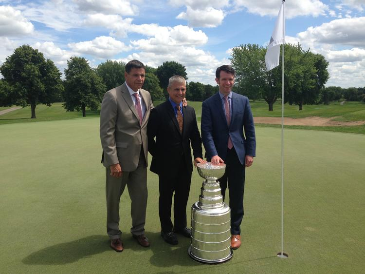 Wirtz Beverage Minnesota executive vice presidents Danny Wirtz (right) and Julian Burzynski (center) and Guy Chipparoni, president of Chicago-based PR firm Res Publica Group, pose with the Stanley Cup at Hazeltine National Golf Club's 18th hole.