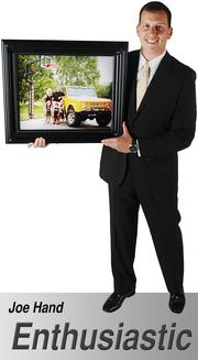 """I chose to bring a picture of my family with my three children in their Wichita State outfits positioned under our Shocker basketball goal and next to the 'Shocker truck' named by our children, which is a 1967 yellow and black Ford Bronco."" - Joe Hand, Vice President, Carbon Products Global Supply, Koch Industries"