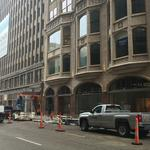 New signs go up for Arcade Apartments
