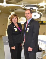 Sherry Hausmann and Richard Allenbach, of Via Christi, in the new operating room. They say it will allow for the expansion of medical services in Wichita.