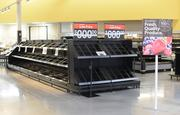 Fresh food shelves waiting to be stocked.