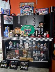 A display case of licensed merchandise commemorating the 50th anniversary of NASCAR.