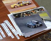 Stacks of photos spanning the career Dale Earnhardt are Dave's current archiving project.