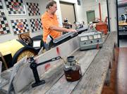 Eddie Roche stands by an original workbench used at the Daytona International Speedway garage. The bench was in use at the garage until a recent renovation.