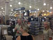 "Cabela's ""outfitters"" Jeff Surry and Jenny Hutchinson show media representatives around the new Lone Tree store."