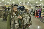 An employee shows off camouflage clothing.