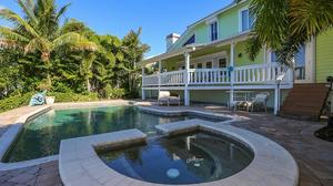 Enter this custom waterfront paradise home