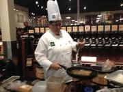 A chef at The Fresh Market prepared French toast and bacon for breakfast on the grand opening day at Mills Park.