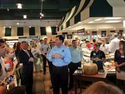Orlando Commissioner Robert Stuart thanks the team that brought The Fresh Market to Mills Park.