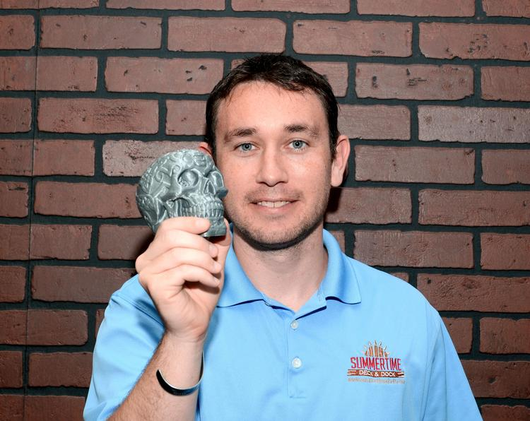 Zack Monninger, co-founder of DeltaMaker, with a skull made on the company's 3-D printer