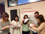 Keller Williams employees surprised with big checks