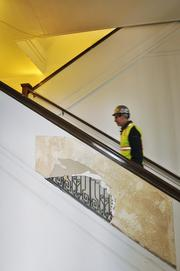 Project superintendent Chuck Furlano, Melinder White on a Great Hall staircase. The railings had been drywalled.