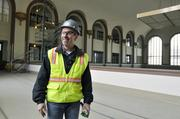 Project superintendent Chuck Furlano, Melinder White, walks the area where a lounge will be located above the bar, replacing the former ticket counter.
