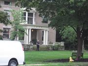 A security guard stood watch outside accused money manager Glen Galemmo's home as items were carried to a moving truck.