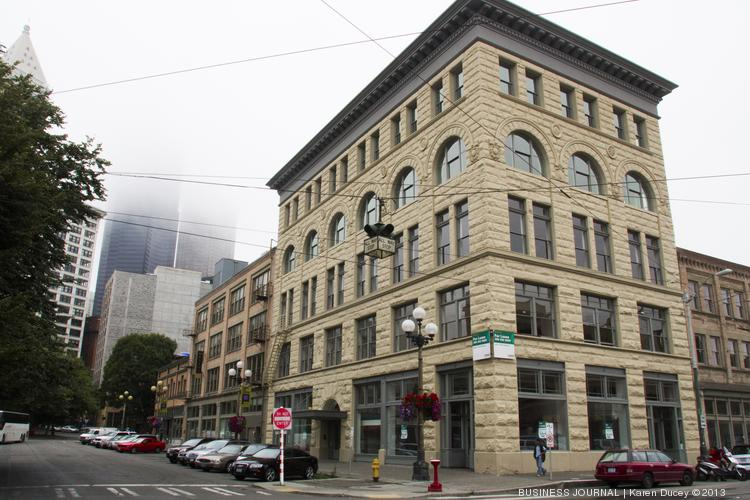 The refurbished Pacific Commercial Building in Pioneer Square, shown here in a 2013 photo, is emblematic of the renaissance occurring in the Seattle neighborhood. A Seattle company, Hal Real Estate Investments, has loaned money to project developer Rob Brewster to finish the rehab of the building.