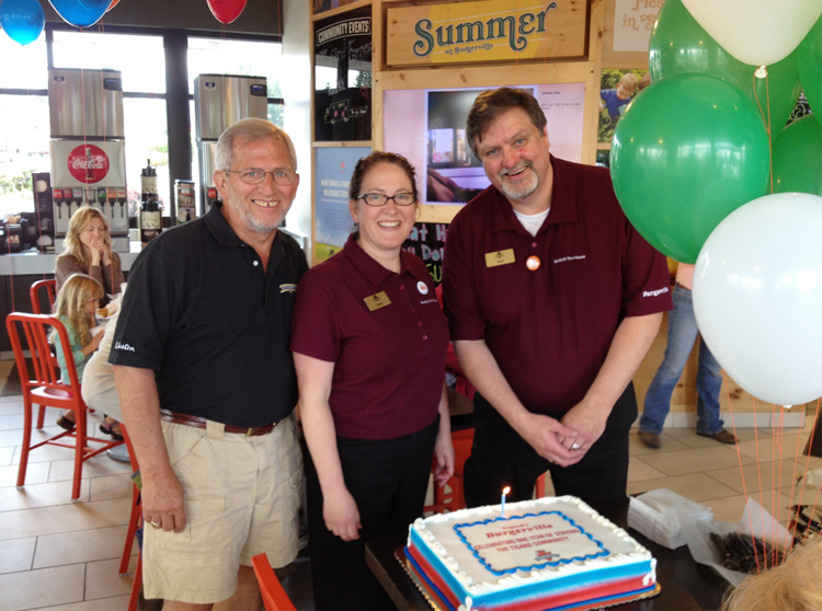 Pictured from left to right are Jack Graves, Burgerville's chief cultural officer, with Burgerville general managers Beth Kelly and Paul Ridlon, at the Tigard Burgerville's first anniversary celebration.