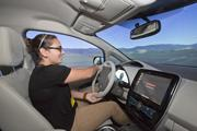 Silicon Valley Business Journal Reporter Lauren Hepler takes Nissan's simulator for a test drive on a virtual road.