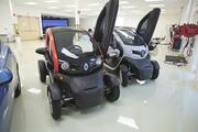 These battery-operated Twizy vehicles are made by Renault (an auto company allied with Nissan) and currently available in Europe. The two-seaters do not have windows and are imagined as a hybrid motorcycle and car.