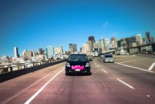 Lyft, whose cars are identified with a bright pink mustache, will launch in Silicon Valley starting Friday