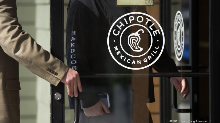 Customers enter a Chipotle Mexican Grill in Martinez, California, U.S., on Monday, Feb. 2, 2015. Chipotle Mexican Grill has been suspected of an E. Coli outbreak in several states.
