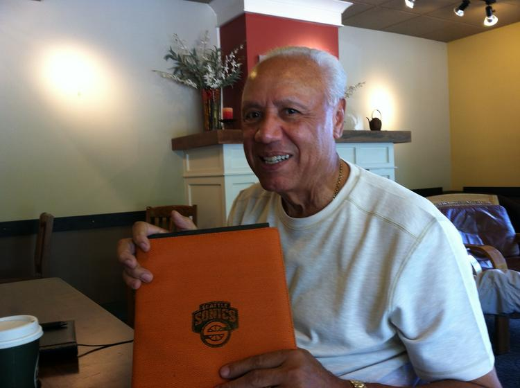 Lenny Wilkens, former NBA player and coach now a philanthropist, poses with a valued leather Sonics folder, which he uses as a notebook. His upcoming August 9-10 fundraiser event is a sellout, attracting big name sports stars.