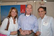 Sara Coon, from left, with James Coon, executive vice president of the National Air Transportation Association, and Michael Korens.