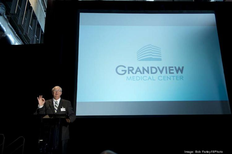 Keith Granger, President and CEO of Trinity Medical Center speaks during the unveiling of the new name for the hospital.