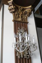 An example of the light fixtures and woodwork inside a hotel ballroom on the sixth floor.