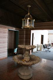 A fountain outside the elevators on the sixth floor of the former Wichita Royale Hotel, which became the Guild Plaza Hotels in 1995, inside Wichita Executive Centre.