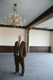 Bryce Baker, vice president-corporate real estate for Security National Capital Inc., stands in a hotel banquet room/ballroom on the sixth floor.