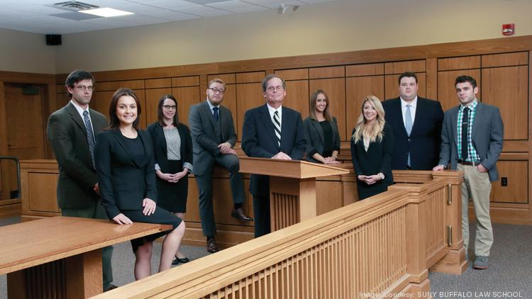 Adjunct professor and trial attorney John Nuchereno, center, is flanked by UB Law students involved in the Innocence and Justice Project: from left, Brandon White, Farina Mendelson, Elizabeth Parson, Jesse Pyle, Kelly Pettrone, Taylor Baker, Brian Barnes and Matthew Parisi.