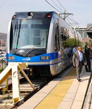Peter Rogoff, who leads the Federal Transit Administration, was in Charlotte recently to mark the start of construction of the Blue Line extension. CBJ's Erik Spanberg talked with him about what a bigger light-rail line could mean for the city.