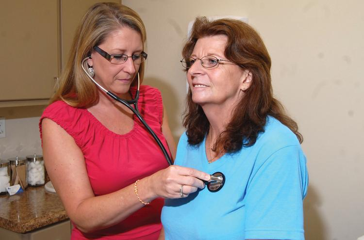 Stephenie Brinson with Hope Family Practice in Garner does a checkup with patient  Marian Cannon.