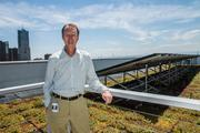 Shaun McGrath, regional administrator for the U.S. Environmental Protection Agency, stands in the rooftop vegetation garden of the Region 9 headquarters in downtown Denver.  There's 20,000 square feet of vegetation on the roofs of the eighth, ninth and tenth floors, which covers 60 percent of the total 35,000-square-foot roof.