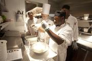 With instruction from executive chef David Himmelberger, line cook Willie Lowe learns to pull mozzarella.