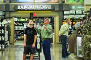 Jeff Butler, flyfishing outfitter at the new Lone Tree Cabela's, gives Koty  Shearman, 13, a few tips before the store opens on Aug. 15.