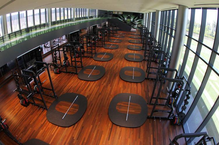 An overhead photo of the weight room demonstrates the clean and modern design of the new facility.
